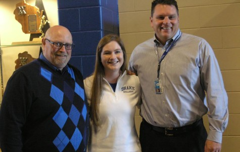 Grace Dunn poses with Athletic Director Todd Sobrilsky (Left) and Principal Brett Greutzmacher (right) Nov. 12, national signing day. Dunn signed her National Letter of Intent in commitment to golfing for the Division One Drake University Bulldogs in the fall of 2015.