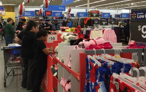 Shoppers flood Walmart on Black Friday, looking for deals on clothes, toys and electronics.
