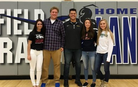 The five proud new college athletes, (from left to right) Crystal Sicard ('16), Joey Koppelman ('16), Brandon Hughes ('16), Alexandrea Lee ('16), and Olivia Zweber ('16) pose right after signing to their future schools.