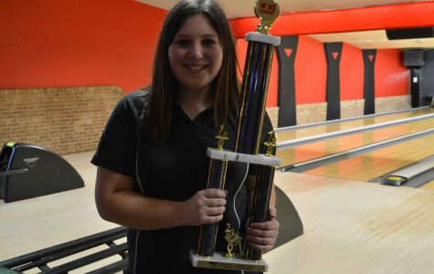 Danyell Chupp ('17) poses with her trophy after winning a conference. Her high game for that day was 277 and her high series was 717.