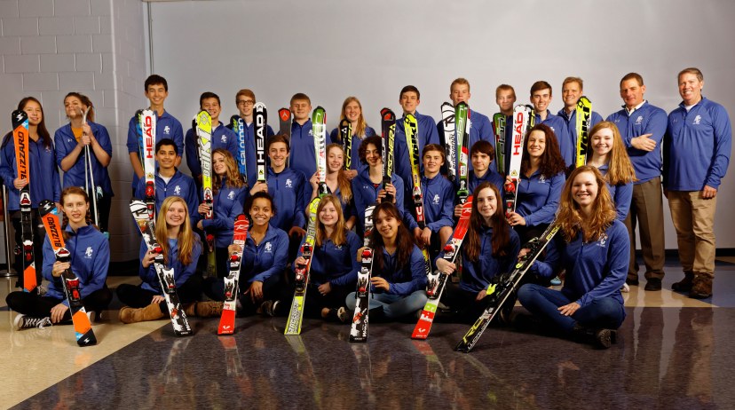 Proud of their accomplishments this year, members and coaches of the BC Ski Team pose for a picture with their skis, which did not let them down this season.