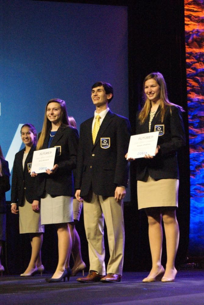 Grace Chialiva ('18, right) poses as the new Wisconsin DECA Vice President of Leadership Development.