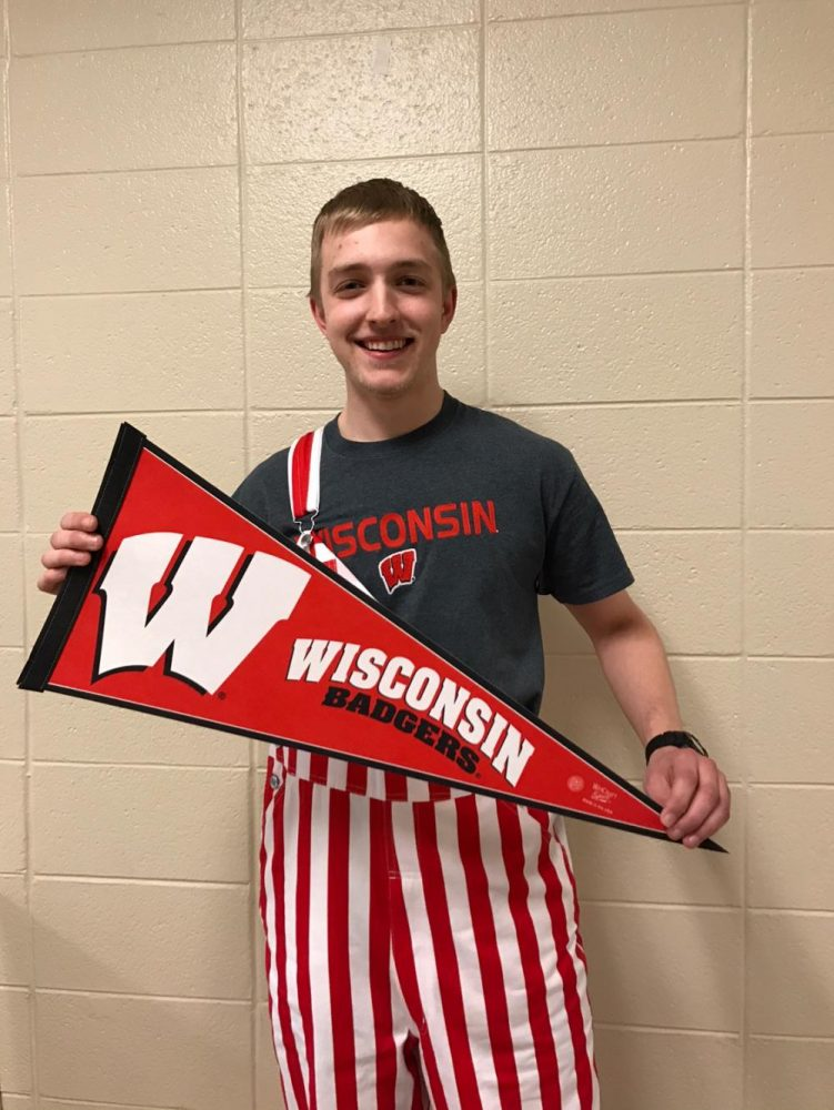Senior+Michael+Elwing+goes+all+out+in+some+red-and-white+pin-striped+overalls%2C+a+UW-Madison+shirt%2C+and+a+matching+banner+to+show+off+his+Badger+pride%21