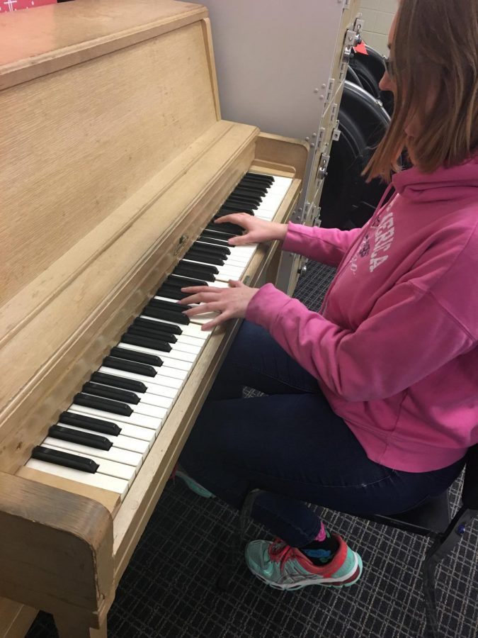 Gwen Rian ('20) practices her class A piano solo in preparation for Solo and Ensemble