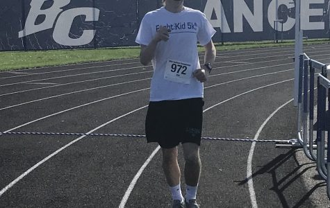 Adam Uy ('20) sprints along the track during the Fight Like a Kid 5k. Out of the 50 participants, Uy finished first.