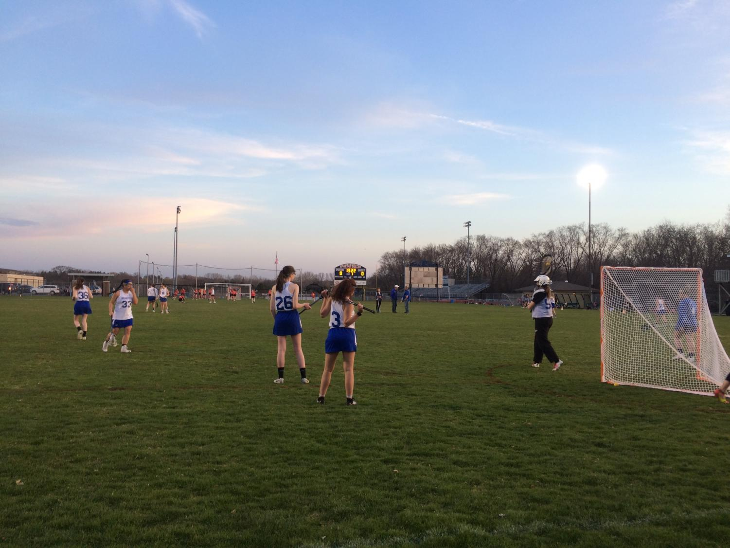 The combined Girls Lacrosse team prepares for a game against Homestead on April 30 on the Brookfield East home turf