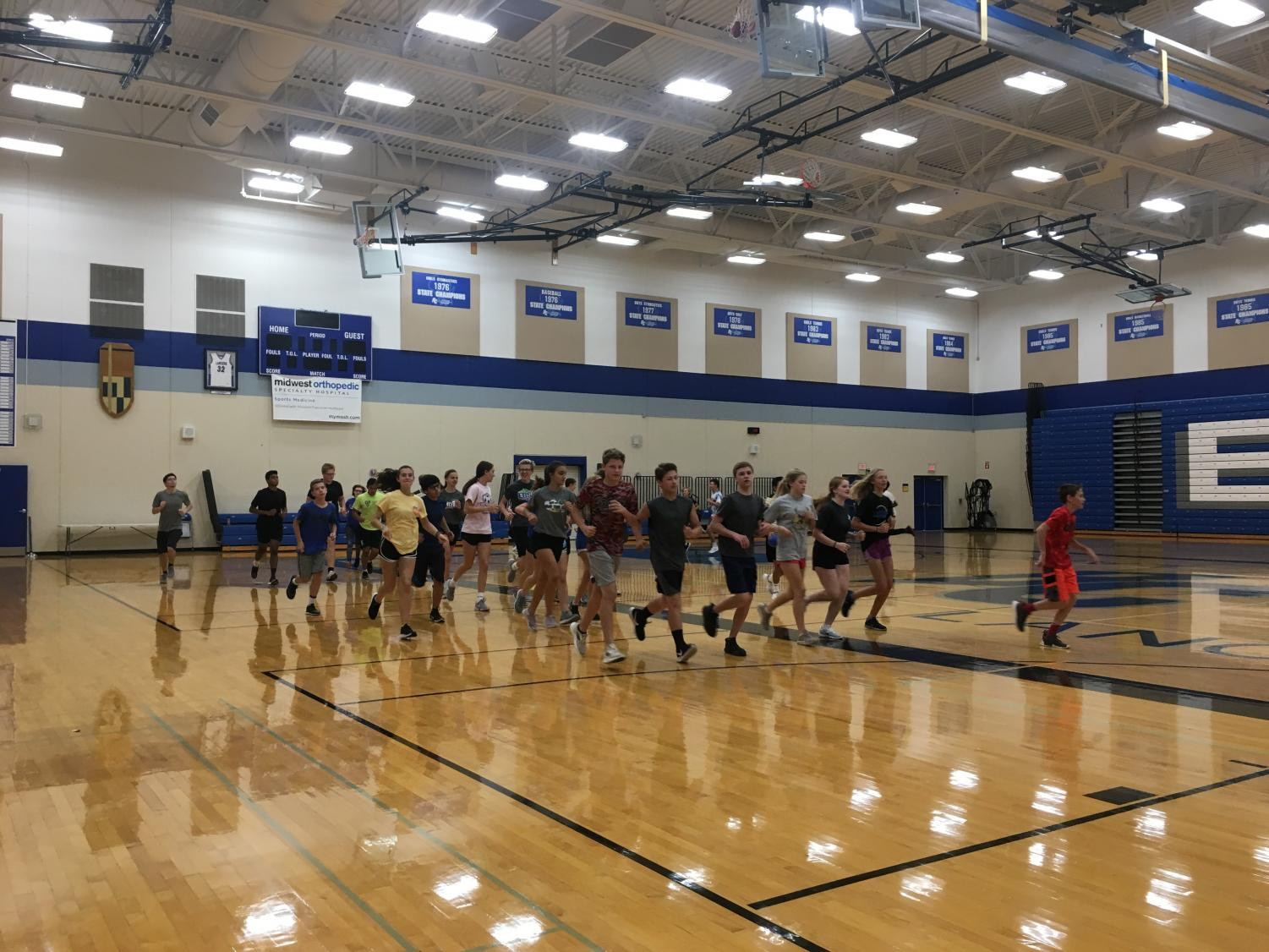 Summer gym students warming up before class. It might look painful, but believe it when people say that  summer gym's worth it