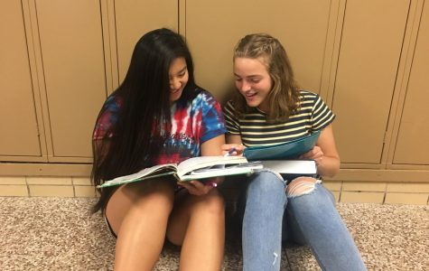 Bella Post ('20) and Leah Cape ('20), working on their summer school homework together.