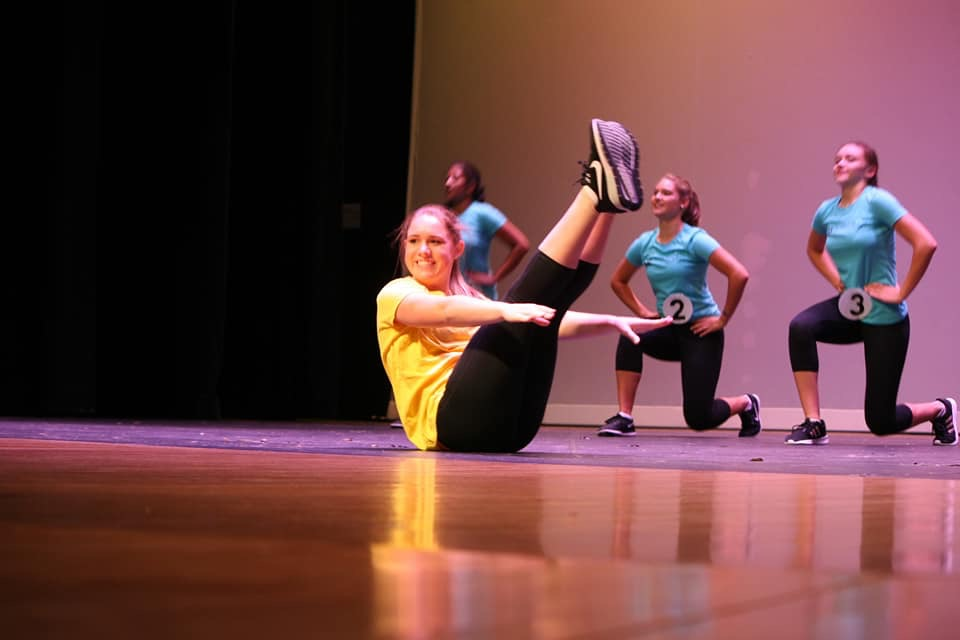 Keane ('19) holds a v-up during her fitness routine at the state competition at the South Milwaukee performing Arts Center.