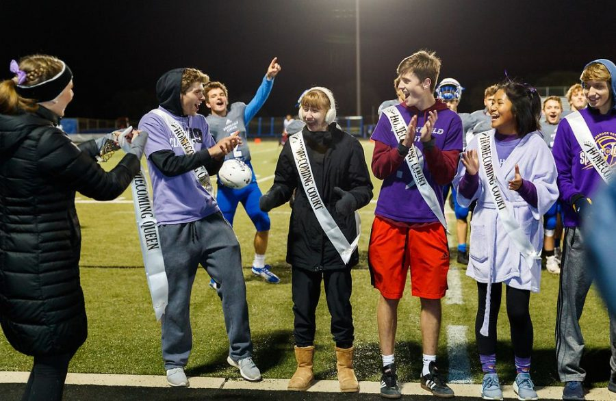 Amidst the cheers of fellow court members and the students section, Hannah Sternberg (19) is crowned queen. Good for her, remarked Malcom Balles (19), she deserved it. Cole Nau was later crowned king. From left to right: Jack Anderson (19), Drew Lesczynski (19), Hannah Sternberg (19), Malcom Balles (19), Hanna Li (19).