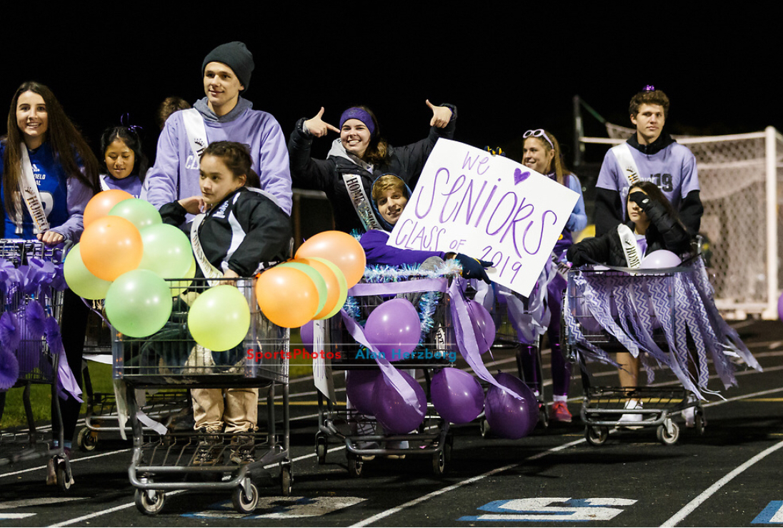 As a part of the traditional Homecoming parade, court members wheel shopping carts around the football field. Each Homecoming court pairing was given a shopping cart to decorate. From left to right: Tallulah Nummerdor, Hana Li, Kevin Jacobson, Megan Kiese, Mary Ellen Ritter, Mark Nemcek, Brooke Barreda, Pierce Boldin, Kelsey Bennett.