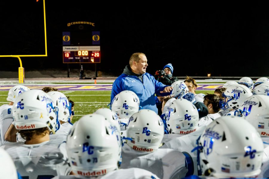 Coach+Kennedy+speaks+to+the+team+after+the+November+9th+game+against+Waunakee+that+sent+the+team+to+the+State+Championship.+