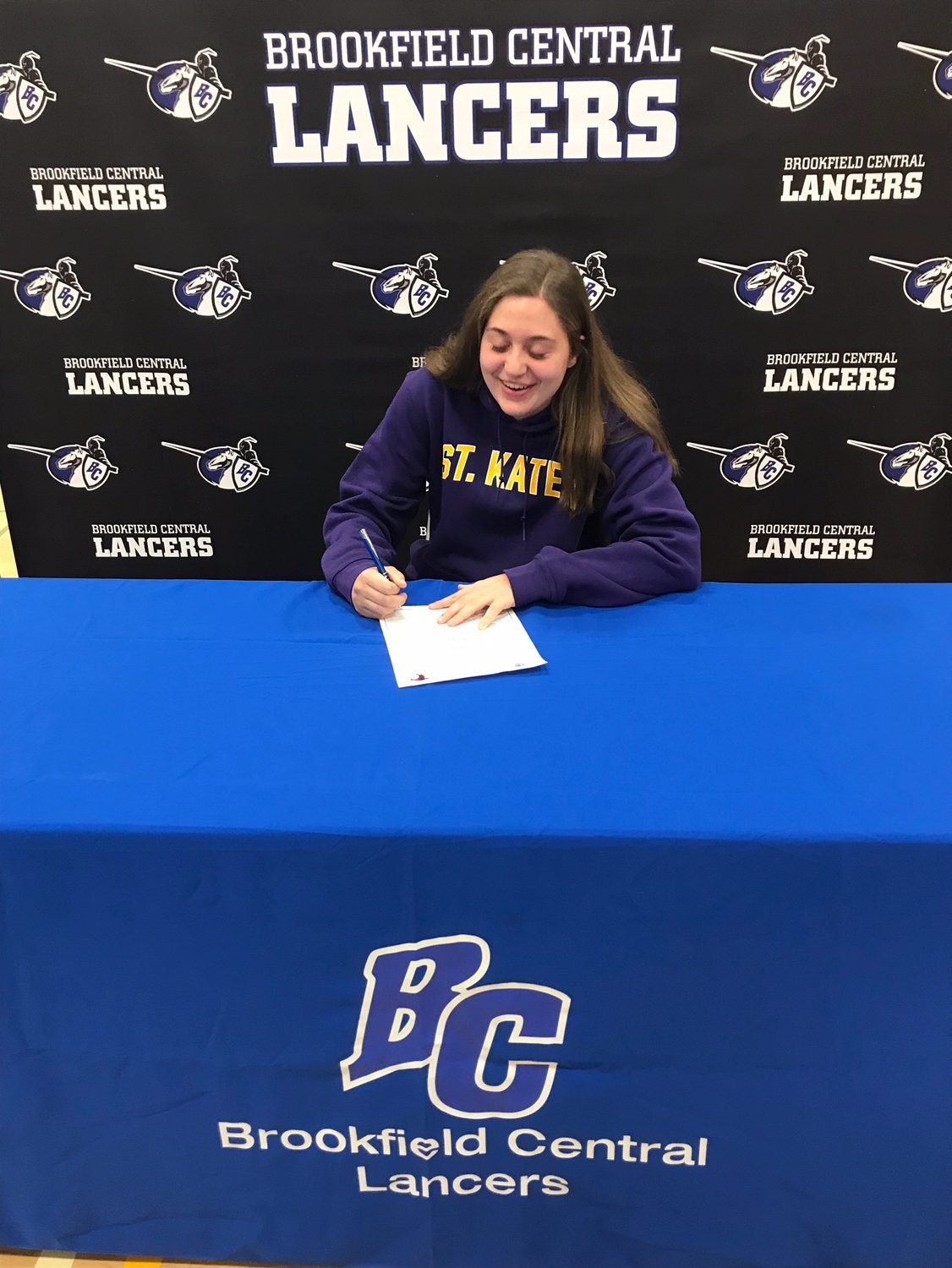 Zoe Sternberg ('19) signs her letter of intent to play hockey at St. Catherine's University which is located in Minnesota.