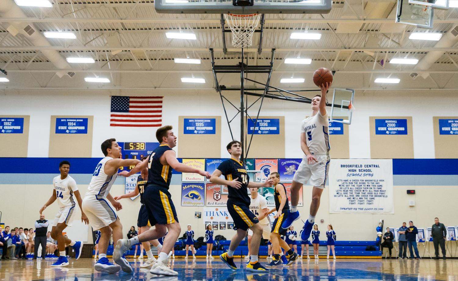 Cola Nau ('19) drives to the basket against Marquette University. he has committed to Hillsdale College to further pursue his basketball career.