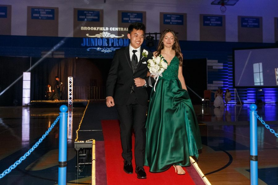 Arms linked, Jacob Tan ('20) and Caroline Durham ('20 stride down the runway, this year's alternative to the staircase typically used for the Grand March. Tan and Durham were the third couple in the march.