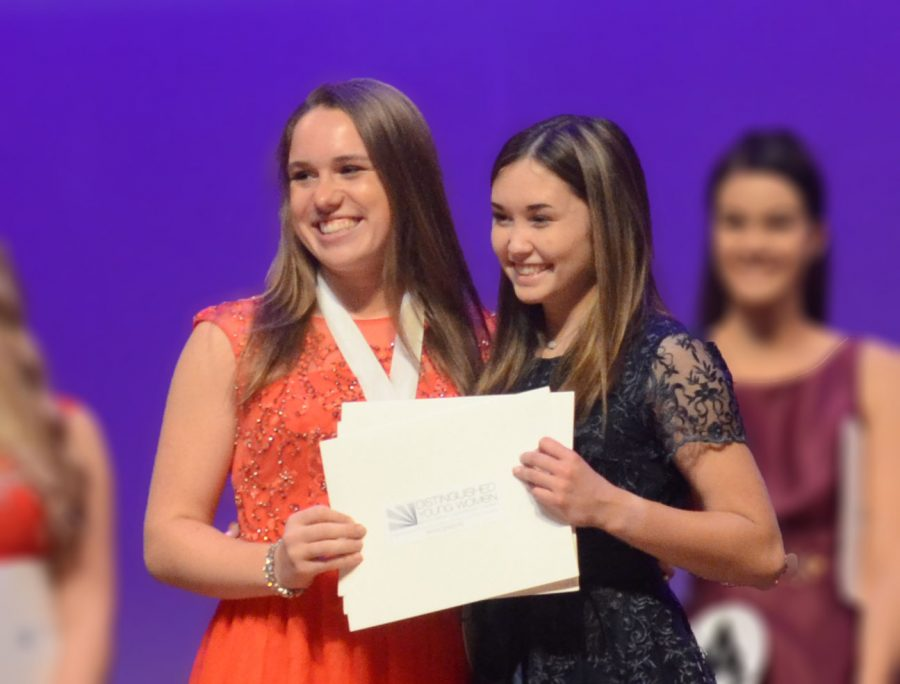 "The 2019 Distinguished Young Woman of Wisconsin, BCHS alumn Amy Keane ('19), presents Riley Feng ('20) with the title of 2020 Distinguished Young Woman of Wisconsin. Feng will be competiting again in June. ""I loved state week so getting to go to nationals will be super fun,"" said Feng."
