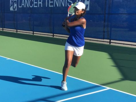 "Manasvi Paturu ('21) goes through her warm-ups in preparation for a match. ""Being on the tennis team has not only helped me become a better tennis player, but I also learned a lot about myself and made a lot of really good friends,"" she says."