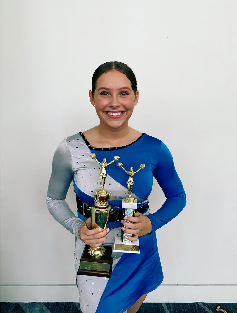 Tollar poses with her trophies after her success at the awards ceremony