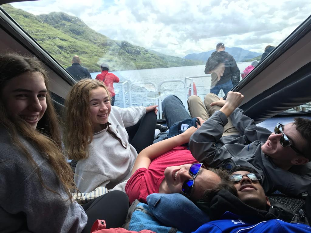 From left to right: Emma Basel ('21), Nathan Tan ('21), Praneil Thankavel ('21), and Evan Bagwell ('21). The students take a boat tour of Killary Fjord during their day trip to Connemara, Ireland. They learned about the potato famine during the tour.