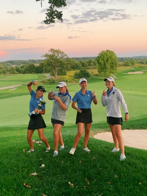 Left to right: CJ Romero ('21), Erin Rosencrantz ('21), Sarah Balding ('22), and Sami Krutz ('20). The girls are celebrating their win at the URidge invite, holding up a trophy and individual medals.