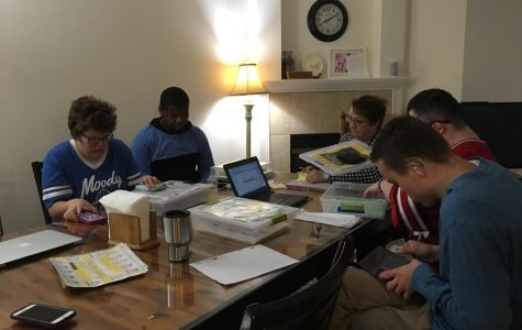 From left to right: Melissa, Elijah, Megan Rindal, Brandon (back), and Brendan. Project STRIVE participants plan out their week with Transitional Coordinator Megan Rindal. Rindal hopes to help the students generalize their learned skills from classroom to home environments.