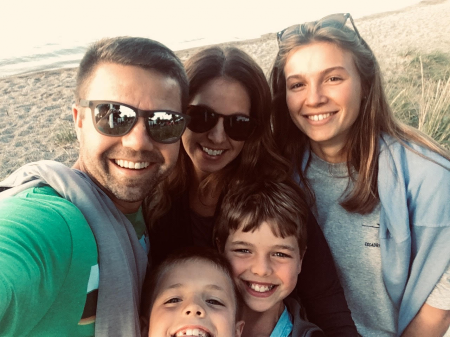 """Maxence Vukovic (top right) and her host family, the Tilkens. When asked about her first experiences in such a different environment, Vukovic explains, """"At first... when you arrive in your host family, you [think] 'I don't know if I can do that' but...they want you in your home, and for it to be your home."""""""