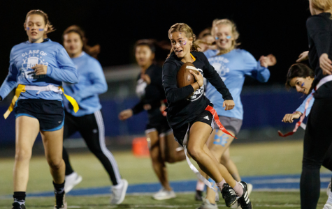 Senior Carissa Kinnart (center) runs the ball to the endzone in hopes of scoring a touch- down. In the last moments of the game, Kinnart ('20) scores, leading her team to victory.