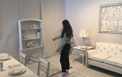Alyssa Karger ('20) points out the fireplace in the new art gallery