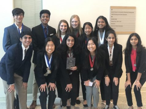 Those who modeled at Mini-Districts are featured here in this photo, Mini-Districts is a low stress way for students to get a feel for the DECA competition environment!
