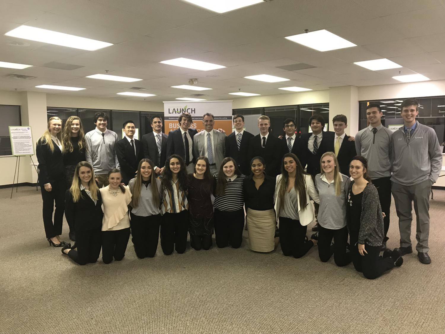 High school students from LAUNCH's 2017-2018 Business Analytics strand pose professionally for the camera after completing autumn project.