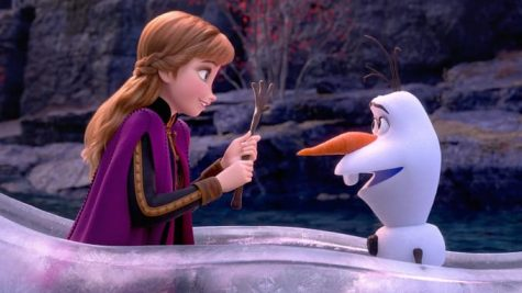 "A screen cap from the movie above shows Anna (Kristen Bell) trying to help Olaf (Josh Gad) while adventuring ""into the unknown""."