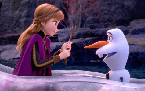 A screen cap from the movie above shows Anna (Kristen Bell) trying to help Olaf (Josh Gad) while adventuring