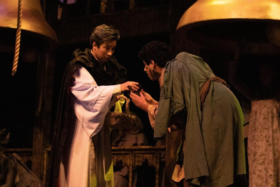 Jonah Morioka ('20) as Frollo and Nishant Namboothiry ('22) as Quasimodo (the Hunchback) in the first scene after the opening number, The Bells of Notre Same. Frollo lectures Quasimodo on the importance of self-control and manners.