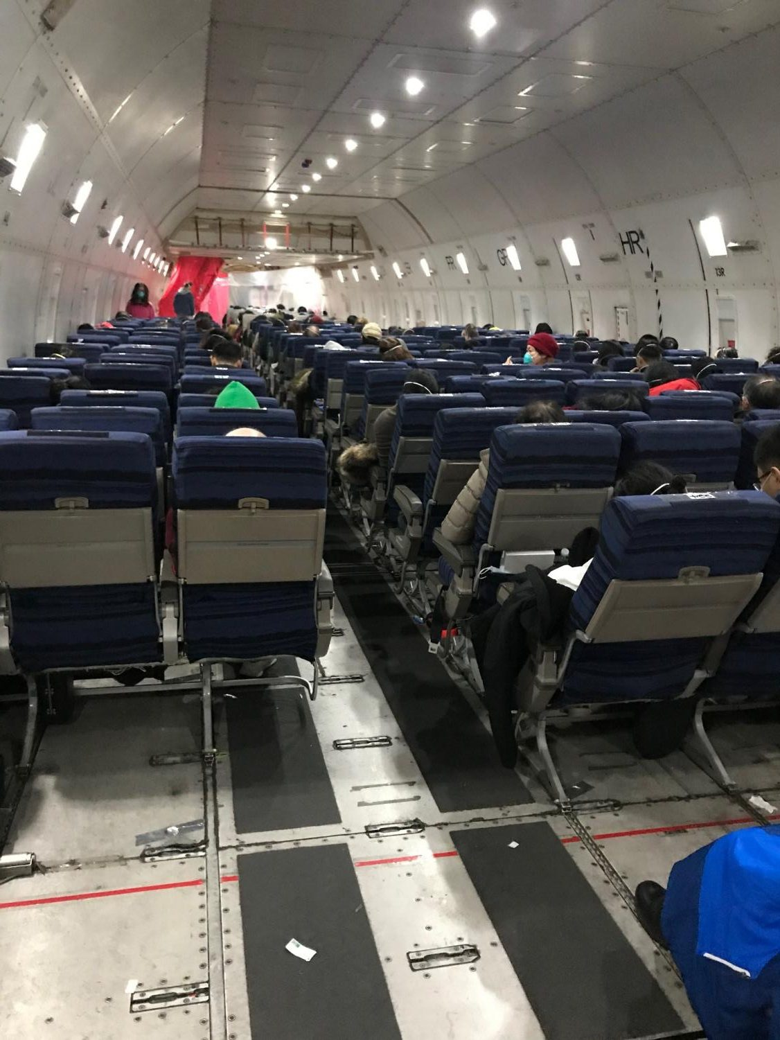This photo, taken by JingMing Huang shows the inside of an airplane, indicating his flight back to America. Air travel has been the greatest cause of the spread of the Coronavirus due to the close proximity of people to one another and the recycling of air throughout the aircrafts.