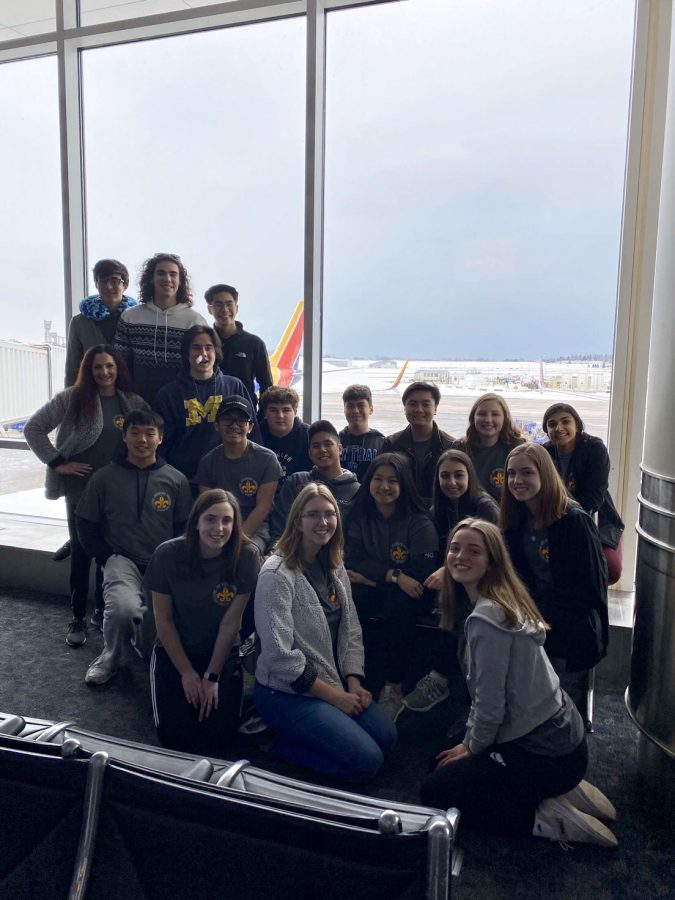 A+group+of+band+seniors+poses+in+General+Mitchell+Airport+before+boarding+Flight+Two+towards+Nashville%2C+Flight+one+boarded+right+on+time+for+Orlando+but+Flight+Two+was+delayed+two+hours.