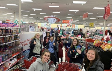 A variety of StuCo members pose for a photo in Target where they are buying gifts for families who cannot afford them. The 'Chirstmas Clearing Council