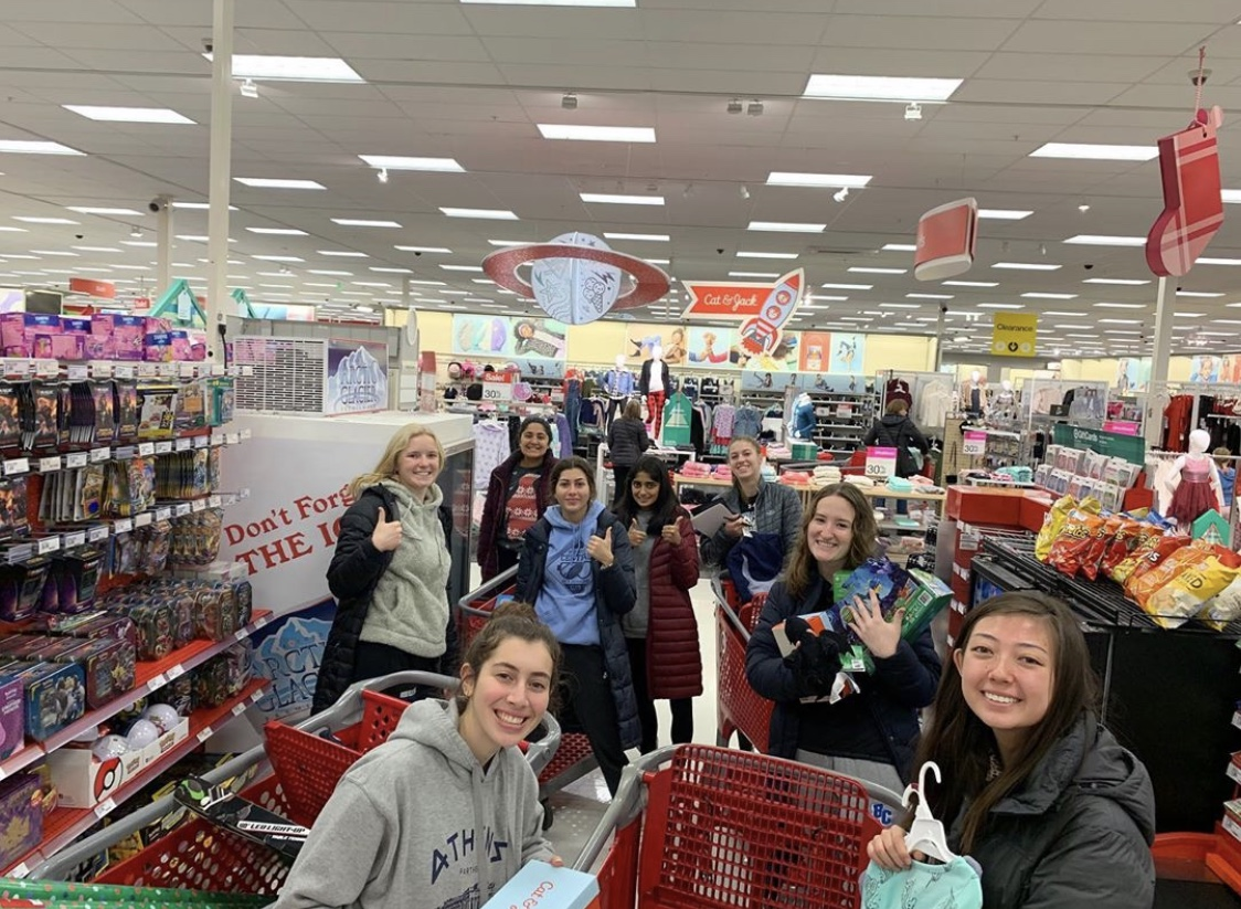 A variety of StuCo members pose for a photo in Target where they are buying gifts for families who cannot afford them. The